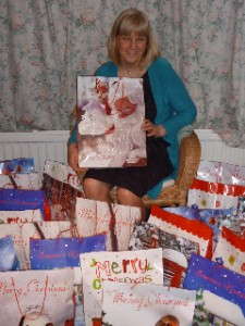Pres. Elect, Jill Smith with Christmas Bags for women in the Under the Bridge hostel