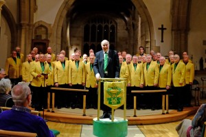 choir of men in yellow jackets