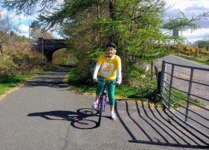 Maggie on her bike