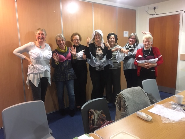 Members modelling the bras they collected to send to Smalls for All.