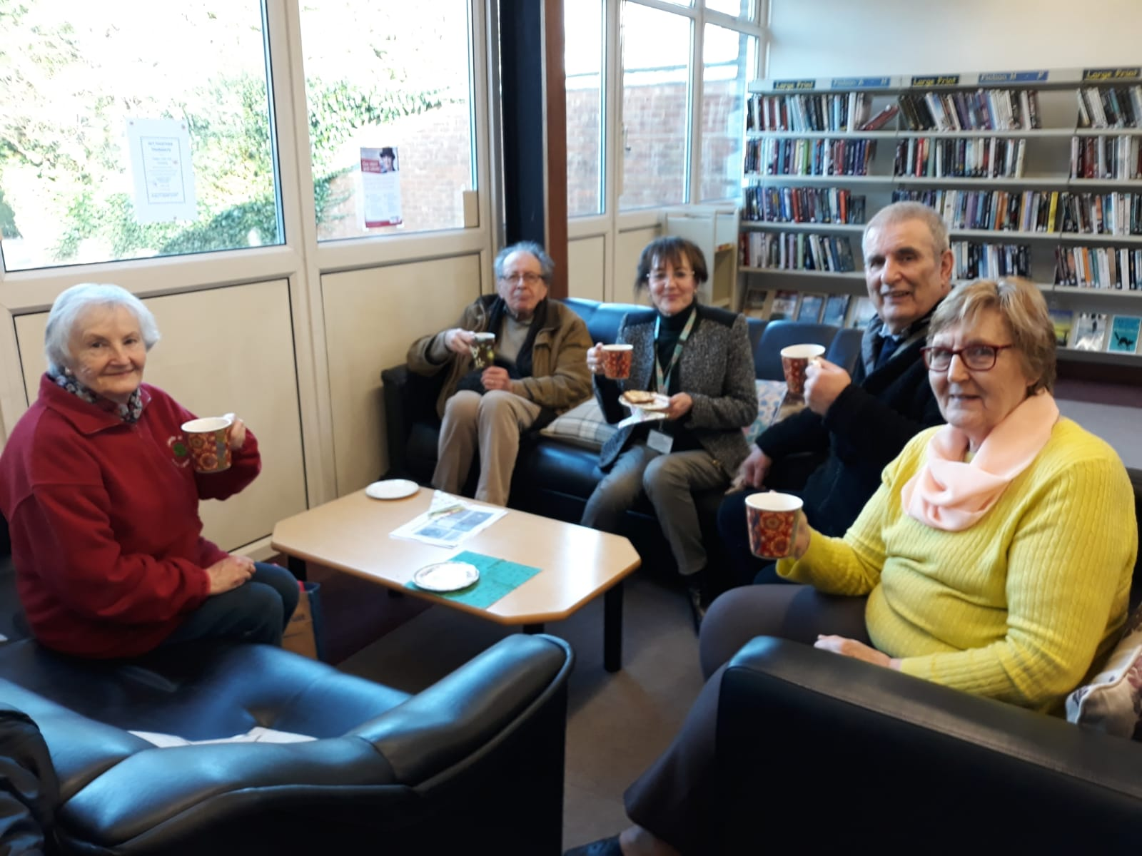 Enjoying refreshments at the weekly cafe event.