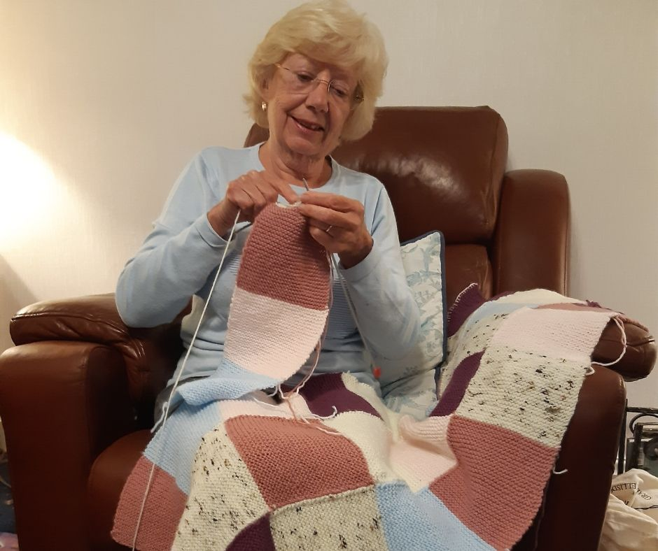 Carol knitting blankets for the fistula clinic in Etheopia