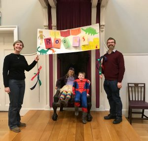 A family who took part in the creative workshop displaying their banner