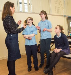 Girls talking informally to a STEM professional