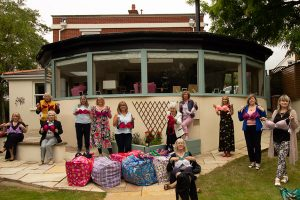 Members celebrate a record bra collection