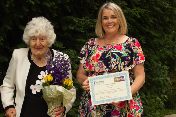 President Eleanor presents Mary with her certificate and flowers