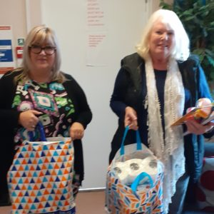 Soroptimists with bags of essential items for local womens aid charity