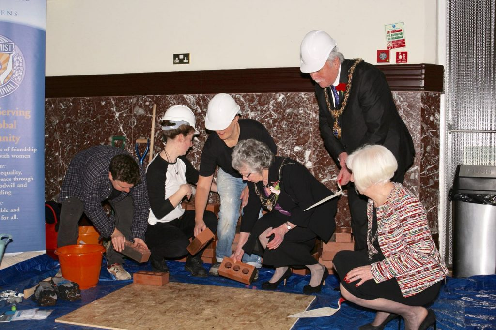 mayor and mayoress go bricklaying