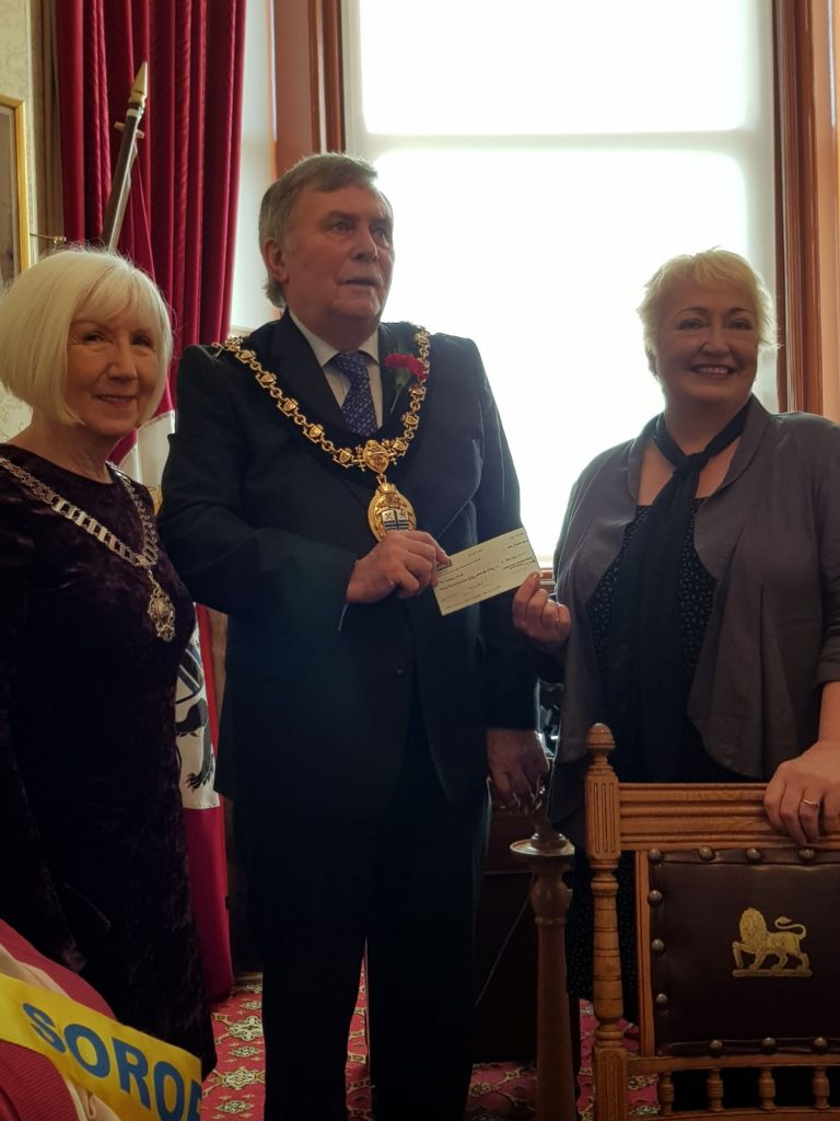 President Sandra presenting a cheque for £750 to the Mayor for his charity St Helens Mind watched by charity coordinator Gill