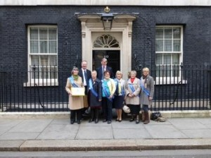 Jeremy Lefroy M.P. Stafford, Bill Cash M.P. Stone, SI Stafford members Kate Brade, Gabby Babbs, Jan Merralls, Jan Hemlin Chair UK PAC, Eileen Manley, Heather Stern. Presented a petition, with 4,296 signatures, to No 10 Downing Street on 6th March 2014 to mark United Nations International Women's Day