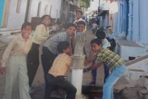 Boys enjoying clean water.