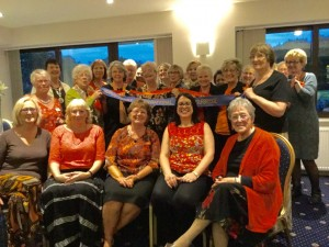 Wearing orange at the September dinner meeting to show support for Violence Against Women