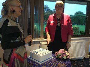 President Ann Hodgson cutting the 70th celebration cake