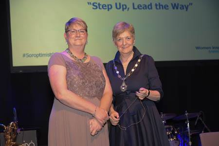 Ann Hodgson (SIGBI IPP) handing over to new Federation President, Sue Biggs (on the right)