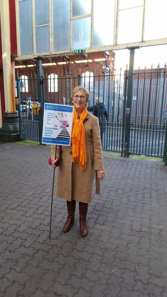 Ruth, member of SI Taunton displaying the poster