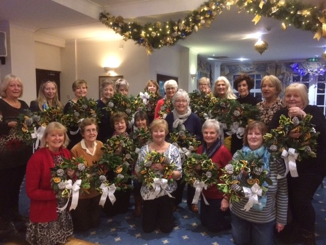 A Christmas theme - members of SI Brixham displaying the wreaths they made at the Berry Head Hotel, with tutor Tracy Johnson.