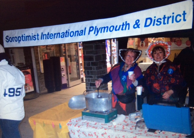 A team of SI Plymouth & District serving hot punch at the annual Tavistock Dickensian evening, raising £500 for local charities.