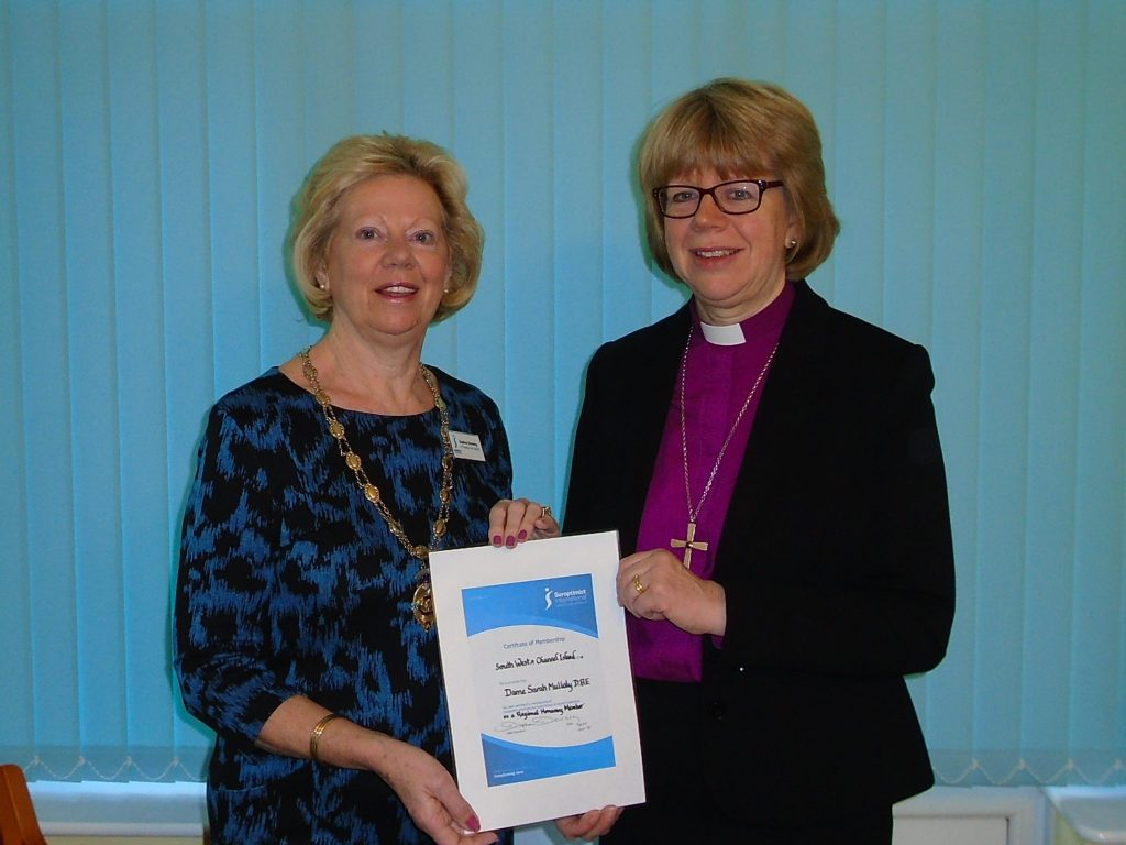 Our congratulations to Dame Sarah Mullally for her appointment as Bishop of London.  Pictured here, when she was Bishop of Crediton, receiving her Regional Honorary membership certificate and badge from Regional President Daphne Dowsing