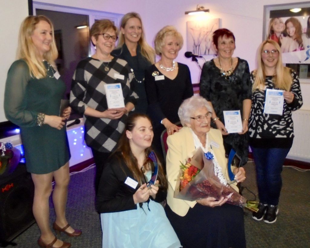 St Austell Soroptimists at their Oscars style awards evening for Unsung Heroines in the community on International women's Day.  The winners, seated, were Julianna Nicholson (aged 15) who has been helping the homeless and Edna Liddicoat (aged 95) who knits items for sale for the Merlin MS Centre.