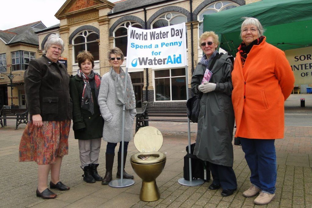 Members of SI Barnstaple & District, invited the public to spend a penny, or more, for WaterAid on World Water Day! (photo courtesy of North Devon Gazette)