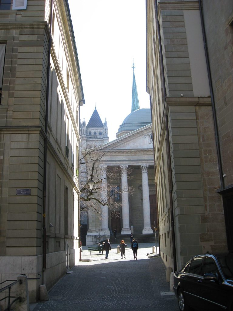 A view of St Peter's Cathedral through the narrow streets of the old town.