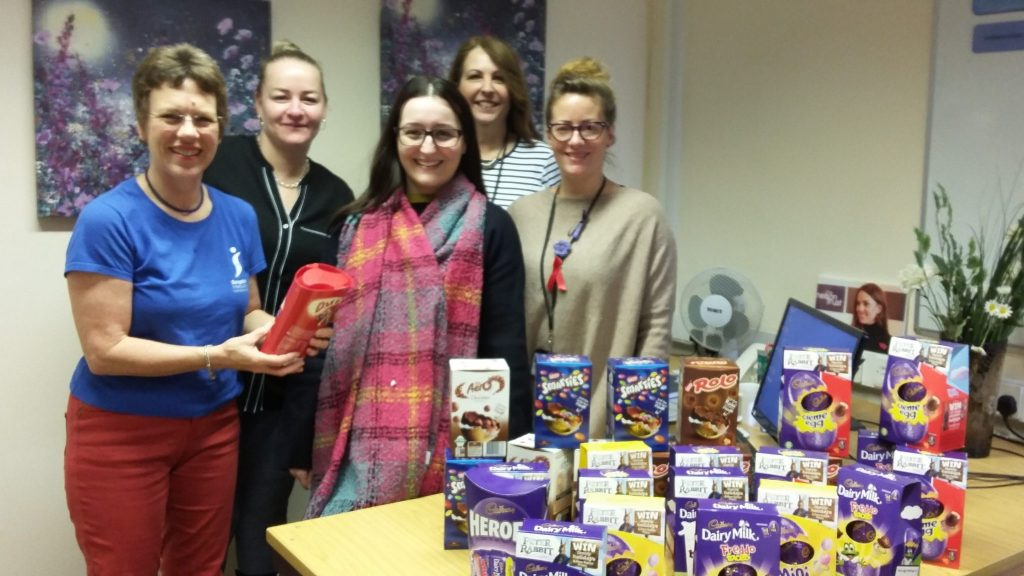 Swindon Soroptimist Lydia Cardew presenting chocolates to the Swindon Nelson Trust Women's Centre hardworking staff  (L-R)  Helen, Veronica, Elaine and Kate, as well as 25 individual Easter eggs for the women who use the Centre and its services.
