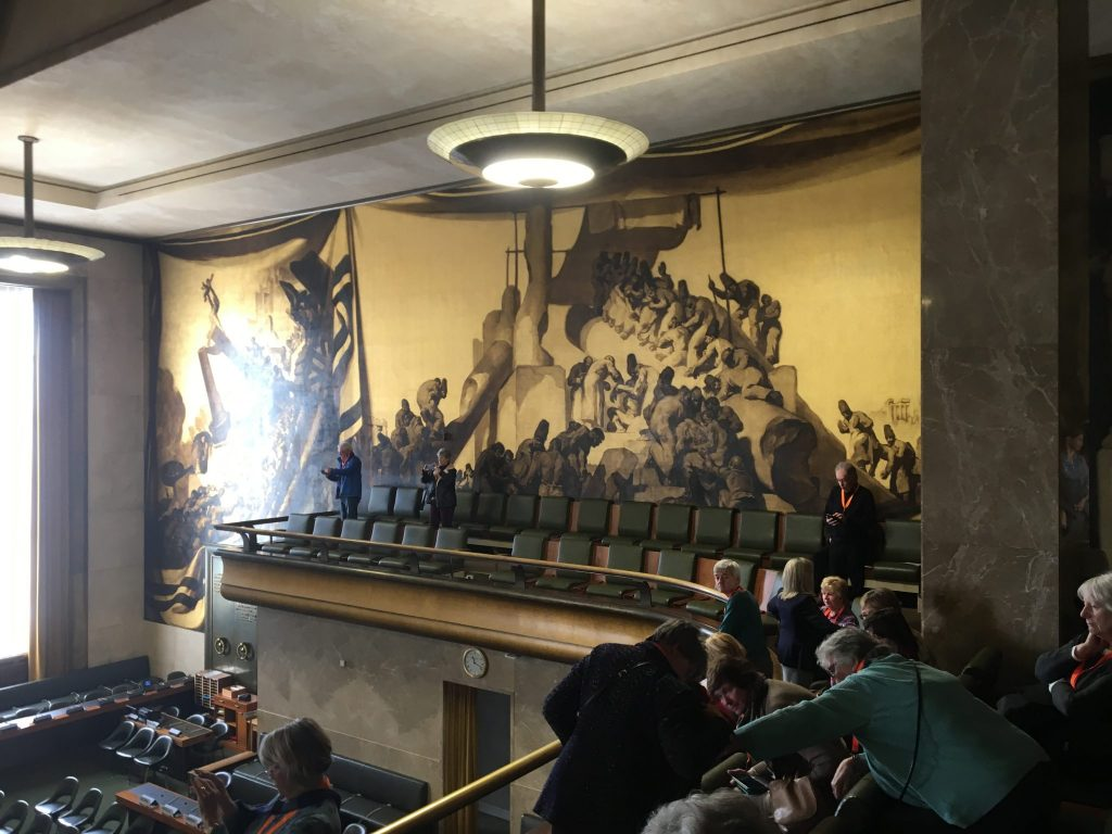 The walls and ceiling of the Council Chamber are decorated with allegorical paintings by the Catalan artist, Jose Maria Sert, depicting technical, social and medical advances and a vision of a future free of conflict.