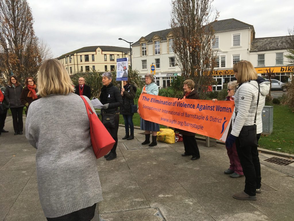 SI Barnstaple & District had a good turnout at their annual petal scattering event for the Elimination of Violence Against Women sixteen days of activism.  These included the Police, Councillors and representatives of local organisations.