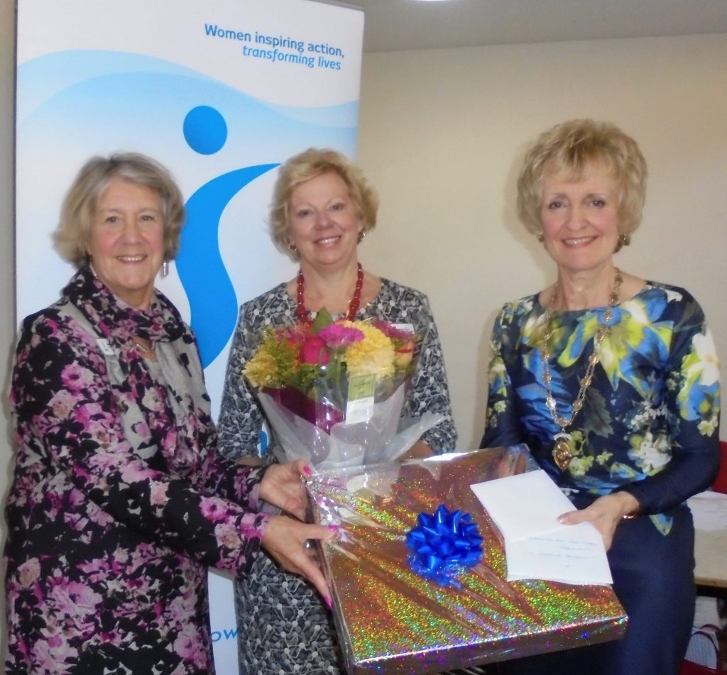 Outgoing President Daphne Dowsing being presented with thank you gifts by incoming Joint Presidents Wendy Plaice and Kay Turner.