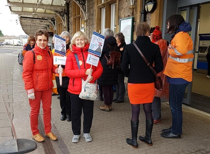 Saying NO! to domestic abuse, Swindon Soroptimist President Valerie and member Lydia, with 40 Soroptimists from South West at the annual  'Railing Against Abuse' event arranged by SI Weston-super-Mare
