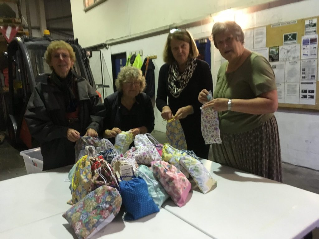 Members of SI Barnstaple packing 30 bags of toileteries which were delivered to the local Women's Refuge during the 16 days of activism (Orange the World).