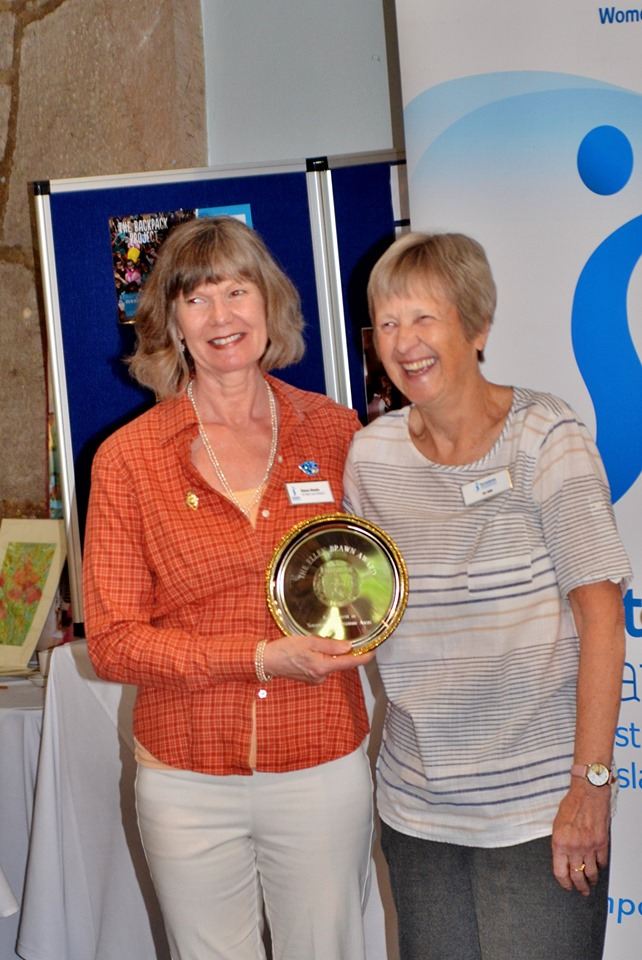 Di Hill, Regional Programme Action Officer, presenting the Ellen Brawn award for best practice to Di Steele, President of SI Bath.