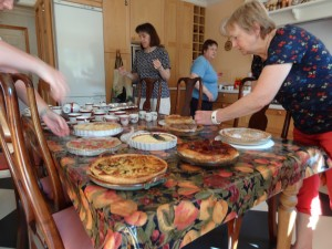 Soroptimists in the kitchen with tarts