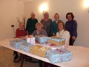 Some members pictured with the Christmas  boxes given to the Swindon Isis Womens Centre