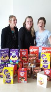 Jackie and Paula with the manager of the Women's Centre and the Soroptimists donation of Easter eggs