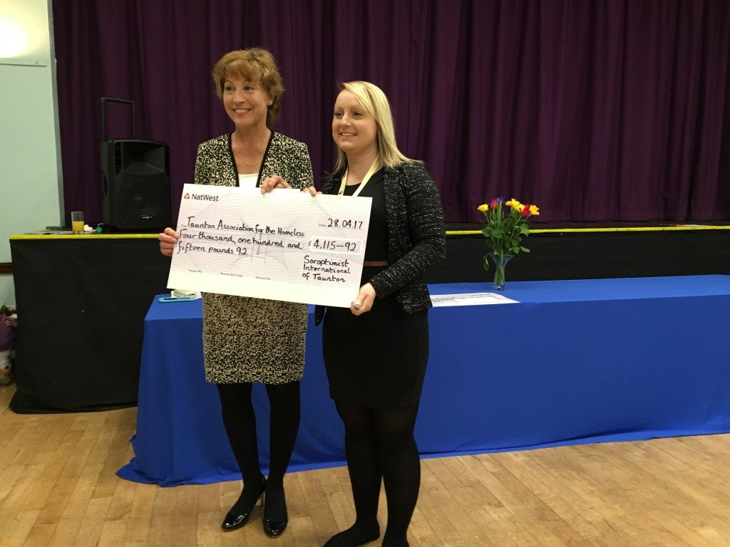 Rosie Hather from Taunton Association for the Homeless receiving their cheque from Rebecca Pow