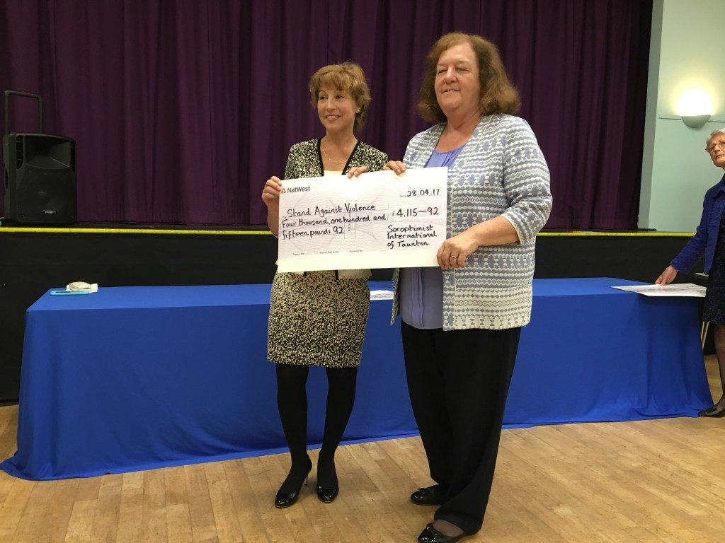 Paula Sudbury from Stand Against Violence receiving their cheque from Rebecca Pow