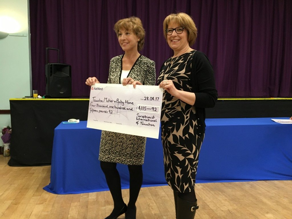 Viv Duncan from Taunton Mother & Baby Home receiving their cheque from Rebecca Pow