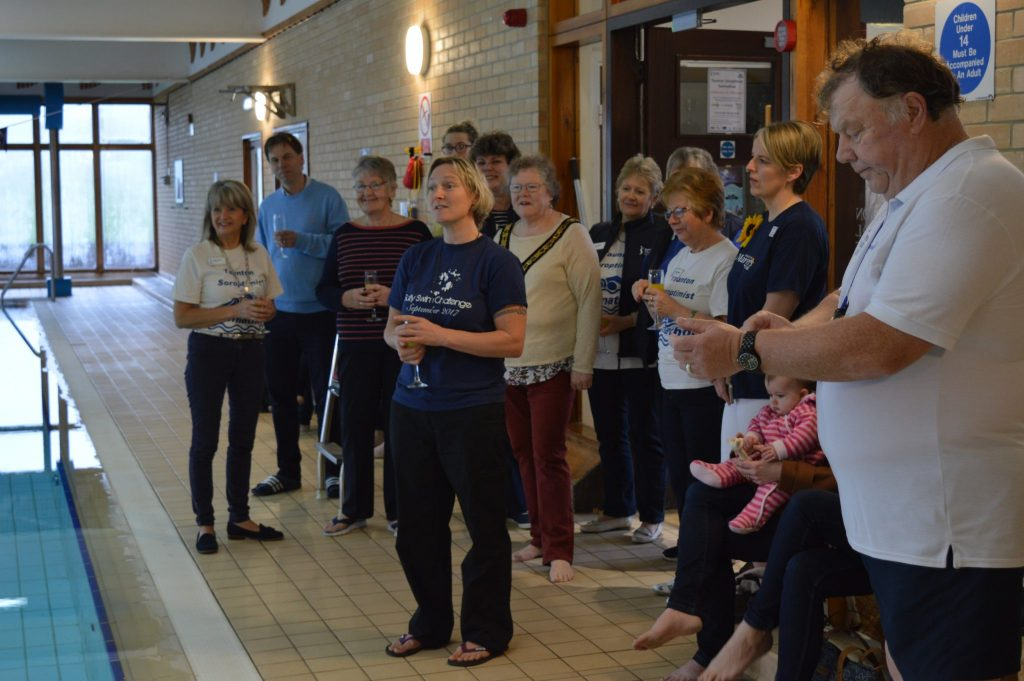 Beth French, ocean swimmer, speaking at the opening ceremony with the Mayor, Hazel Prior-Sankey, Head of Taunton Prep School, Andrew Edwards, Sadie Ellison from St Margaret's Hospice, Terry Beale, our Referee, and Jeanette Keitch, a Soroptimist who helped get the Swimathon up and running 30 years ago.