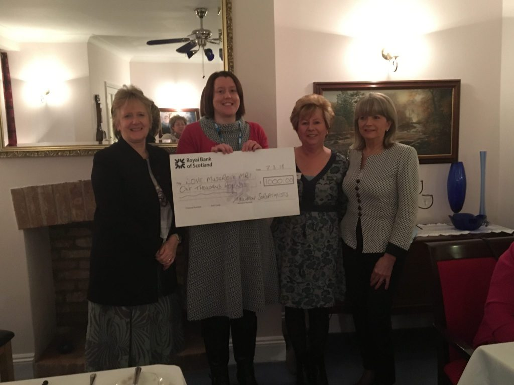Presidents Jane and Rhona, along with Christine, present a cheque for £1,000 to Zoe Steer of Love Musgrove charity - money raised by the annual Quiz Night in January 2018