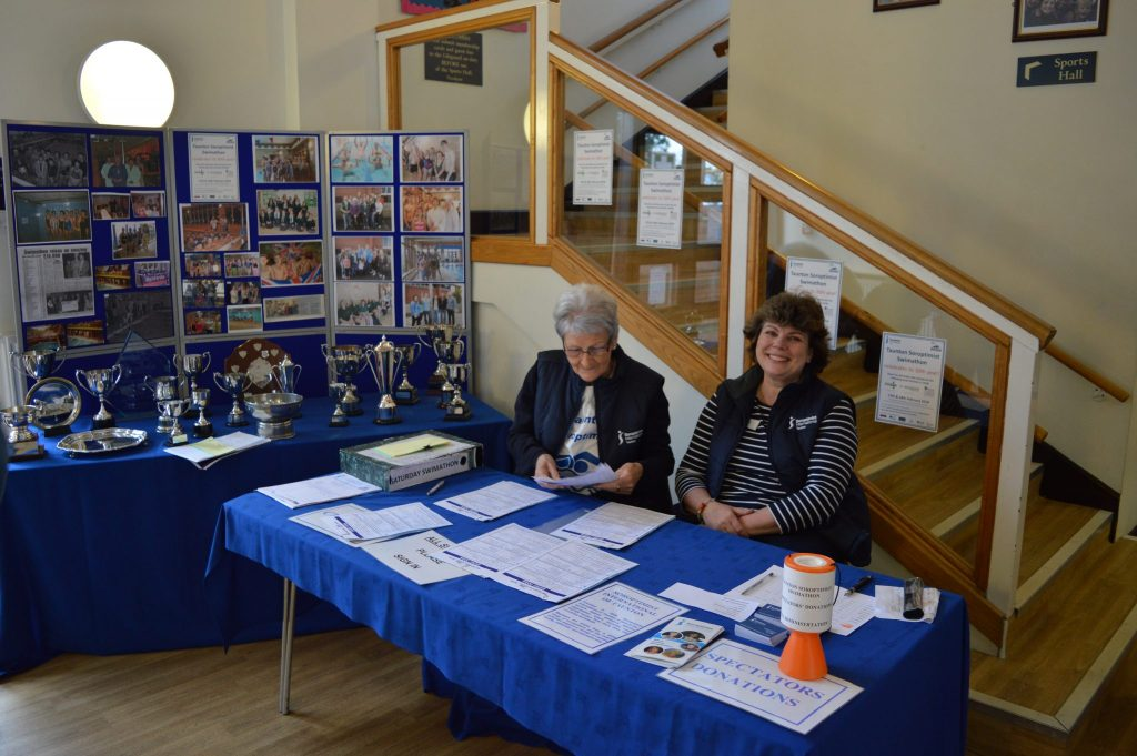 Pauline and Sue at the Check-in Desk on Saturday morning
