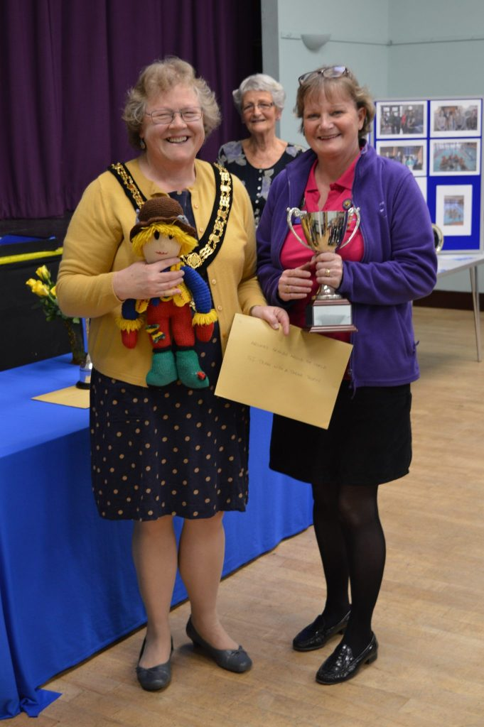 The Soroptimist International Team with a Theme trophy for the Team with the Best Theme awarded to Archie and his friends around the world from Reminiscence Learning