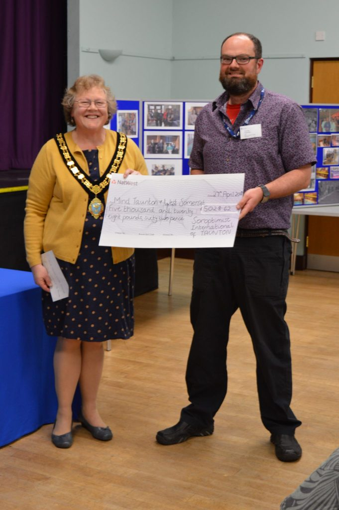 Andrew Pritchard from Mind in Taunton and West Somerset receives their cheque