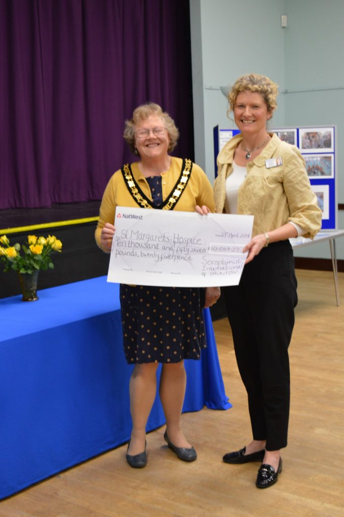 Joy Milliken - Clinical Director at St Margaret's Hospice receives the Hospice cheque (the Hospice received 50% of the amount raised)