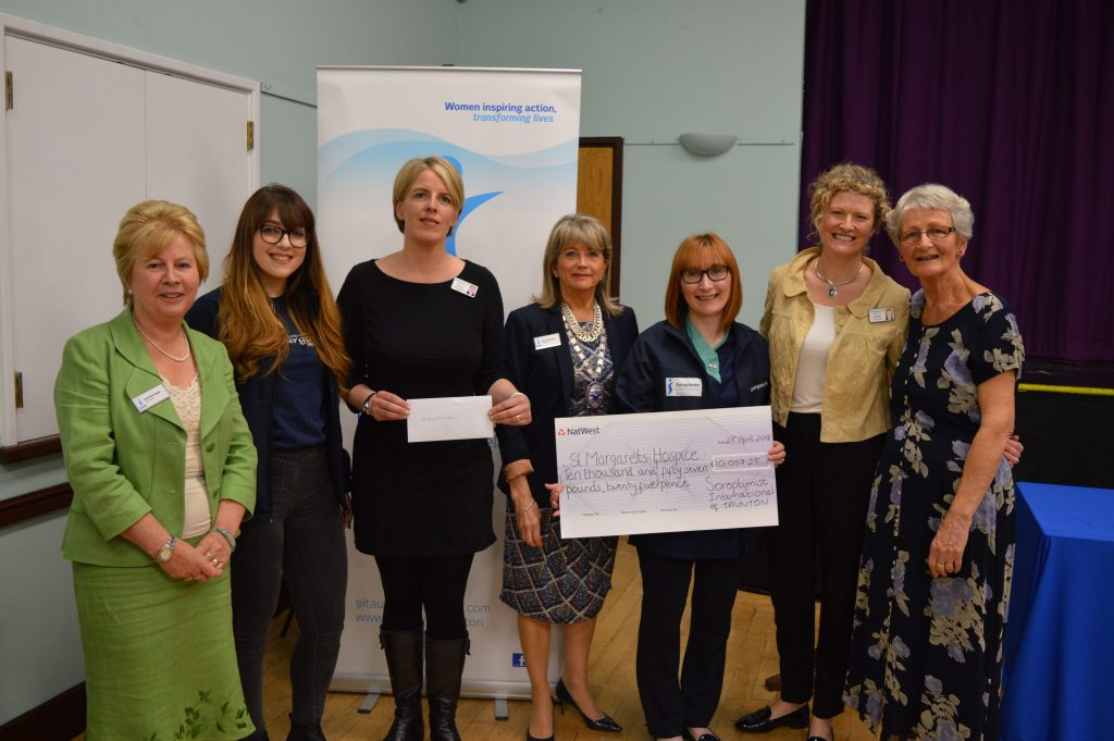 Rhona, Christine and Pauline from SI Taunton with staff from the Hospice - Joy Milliken Sadie Ellison Kara Frampton and Community Nurse Sophie Saint.  The money granted to the Hospice will be used to sponsor Sophie for the next year.