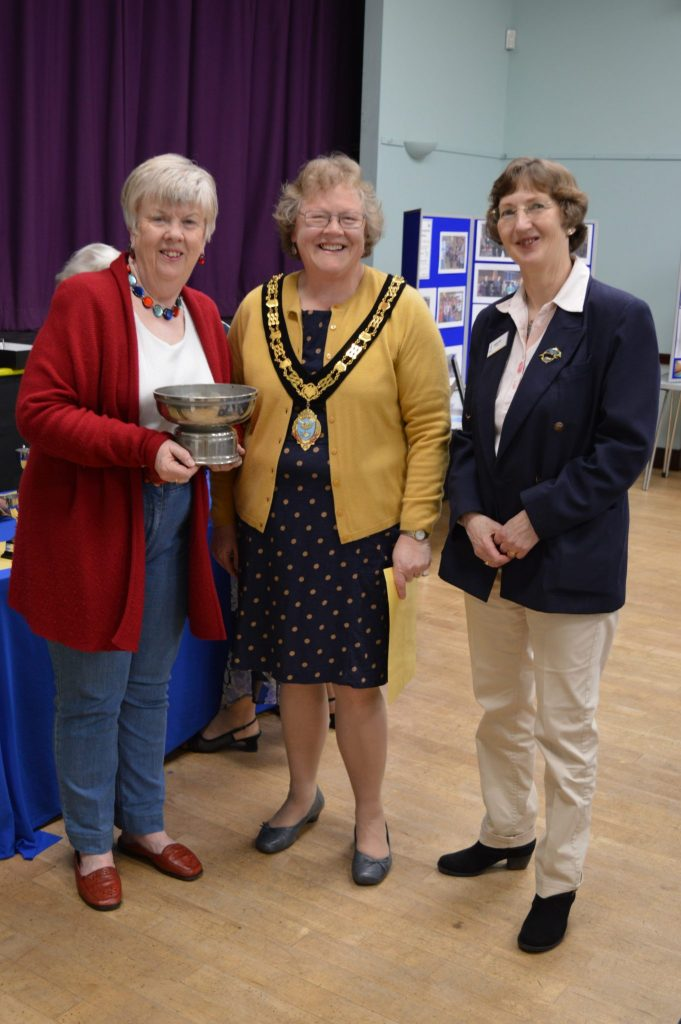 Anne and Abby from the Soroptimist Swans receive the Westbury Homes Trophy for the single team raising the most money - £1103