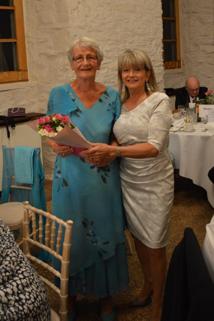 Joint President Rhona gives Pauline Clarke flowers as a thank you for making the delicious anniversary cake