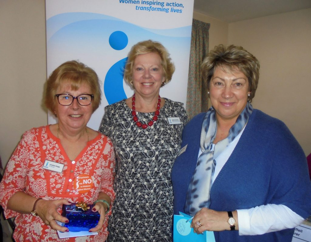 Immediate Past President Daphne Dowsing (centre) presents gifts to SI Taunton members Christine Briggs, outgoing Benevolent Fund Representative and Sally Williams, outgoing Federation Councillor at the SW&CI Regional Meeting