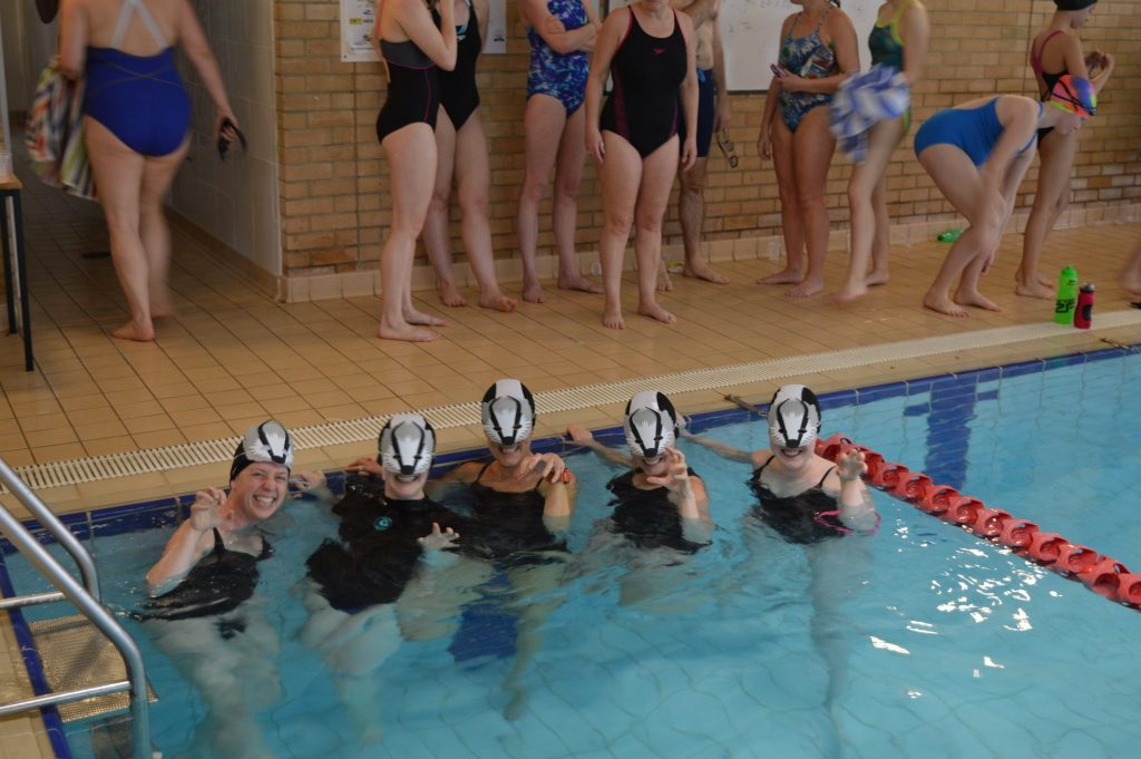 Wildlife Trust entry, the Bathing Badgers.  Looking great in their badger outfits and carrying the Team with a Theme into the pool.