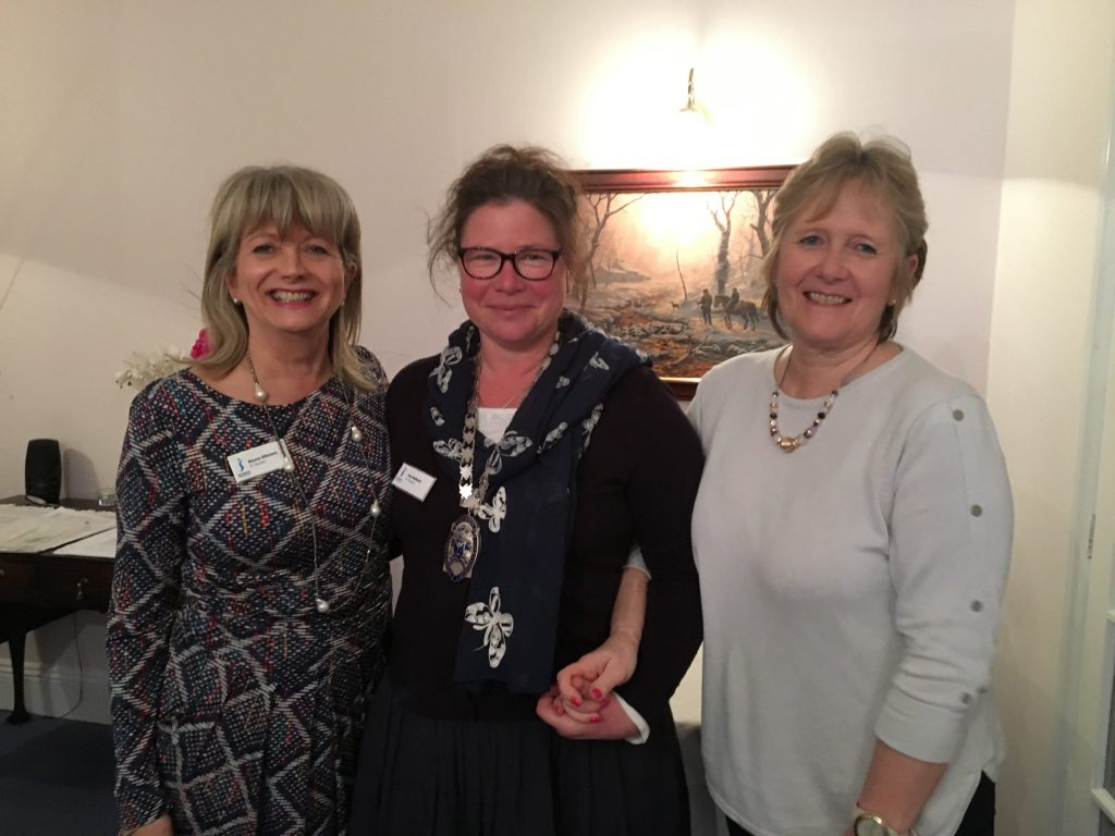 President for the month of May, Fee Bellamy, receiving the chain from Immediate Past Presidents Rhona Gillmore and Jane Fitzgerald.